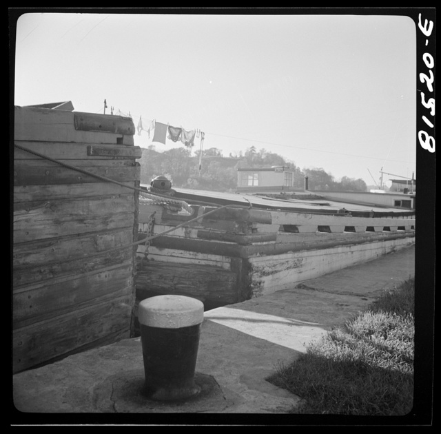 Barges passing through Lock Eleven. Erie Canal, New York
