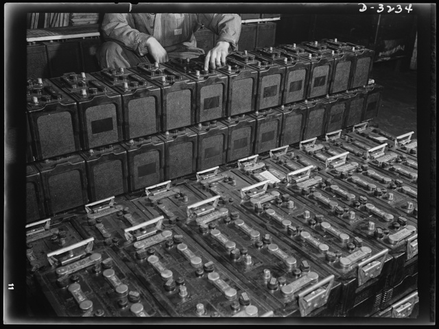 Batteries for the halftrac scout cars being made at a large Midwest truck plant must have no defects. They won't have after the inspectors have checked their performance. White Motor Company, Cleveland, Ohio