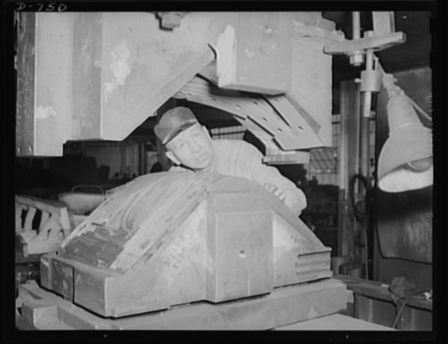 Before dies are shipped they are tested in actual use in tryout presses, where their operations are closely scrutininzed by expert die makers. One of these has just placed the die in the tryout press shown here. Frederick Colman & Sons, Inc., Detroit, Michigan