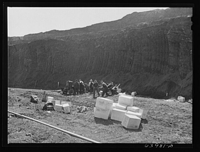 Blasting crew boring into vein with horizontal drill for dynamiting. Mahoning pit, Hibbing, Minnesota