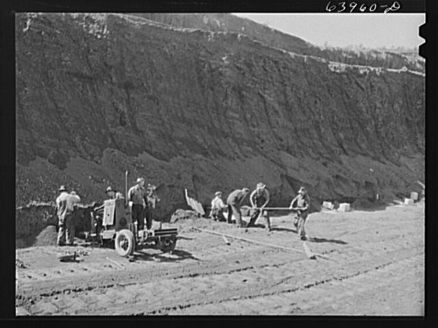 Blasting crew going into ore vein with horizontal drill. Mahoning pit, Hibbing, Minnesota