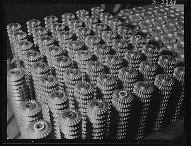 Bofors forty-millimeter mounts. Gears for guns-for-victory. Hundreds of these precision cut gears roll off specially designed gear-cutters daily in the Bofors plant of a large rubber factory. When assembled, they'll be part of the Bofors forty- millimeter anti-aircraft gun mounts and carriages, some of the war essentials now manufactured in a plant whose sole product used to be tires for the family sedan