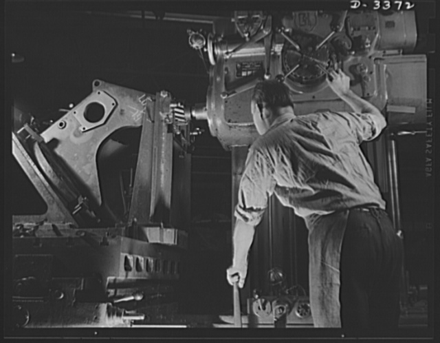Bofors forty-millimeter mounts. The final operation in the manufacture of gun carriages for the Bofors forty-millimeter anti-aircraft guns is taking place on this horizontal milling machine. A workman of a large Midwest rubber company converted to war production is milling the top bearing trunion pads or supports. When this operation is complete, the carriage will be ready for attachment to the chassis which supports the gun and barrel