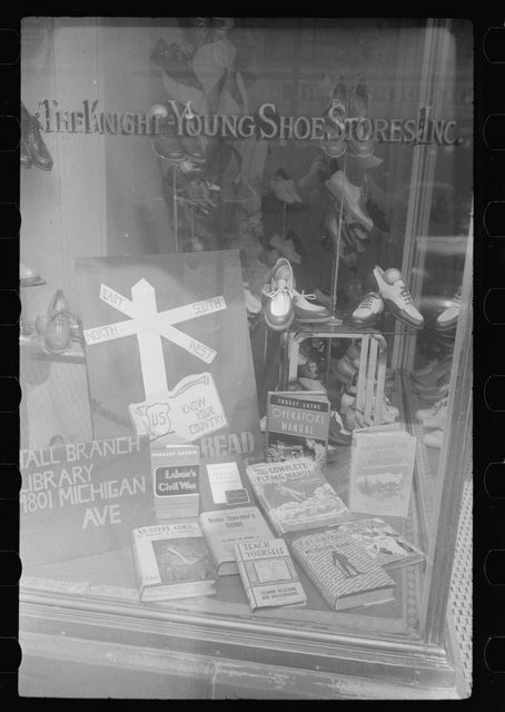 Books on display in show store window, 47th Street, Chicago, Illinois