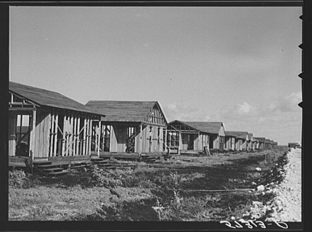 Buildings being erected for migratory labor in Pahokee, Florida