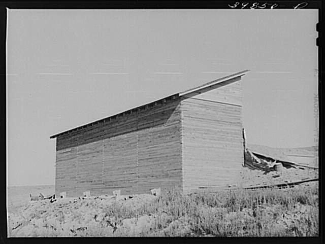 Bulk wheat elevator on farm. This elevator was built from plans drawn up and furnished by the State Extension Service and AAA (Agricultural Adjustment Administration). These farm elevators are designed to take care of the bumper crop of wheat this year for which there is not adequate storage space. Walla Walla County, Washington