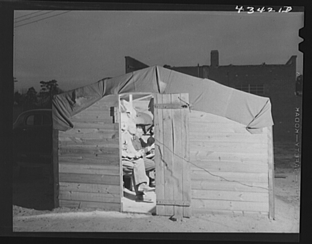 Bunkhouse in a settlement of construction workers who work at Fort Bragg. Near Fayettevellie, North Carolina