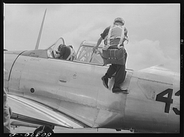 Cadet mounting plane prior to training flight. Craig Field, Southeastern Air Training Center, Selma, Alabama