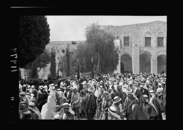 Calendar of religious ceremonies in Jer. [i.e., Jerusalem] Easter period, 1941. Neby Mousa [i.e., Nebi Musa] banners presented by Mr. Keith Roach. Flags carried in procession toward Mosque el-Aksa [i.e., al-Aqsa]