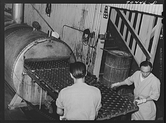 Canned and cooked salmon goes through sterilizing vats. Columbia River Packing Association, Astoria, Oregon