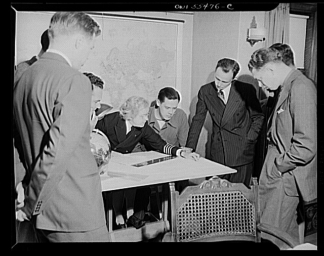 """""""Captain"""" Mary Converse, instructing V-7 (candidates for United States Navy ensign commissions) students in use of sextant, compass and gyroscope and in navigation. Classes are held in dining room"""