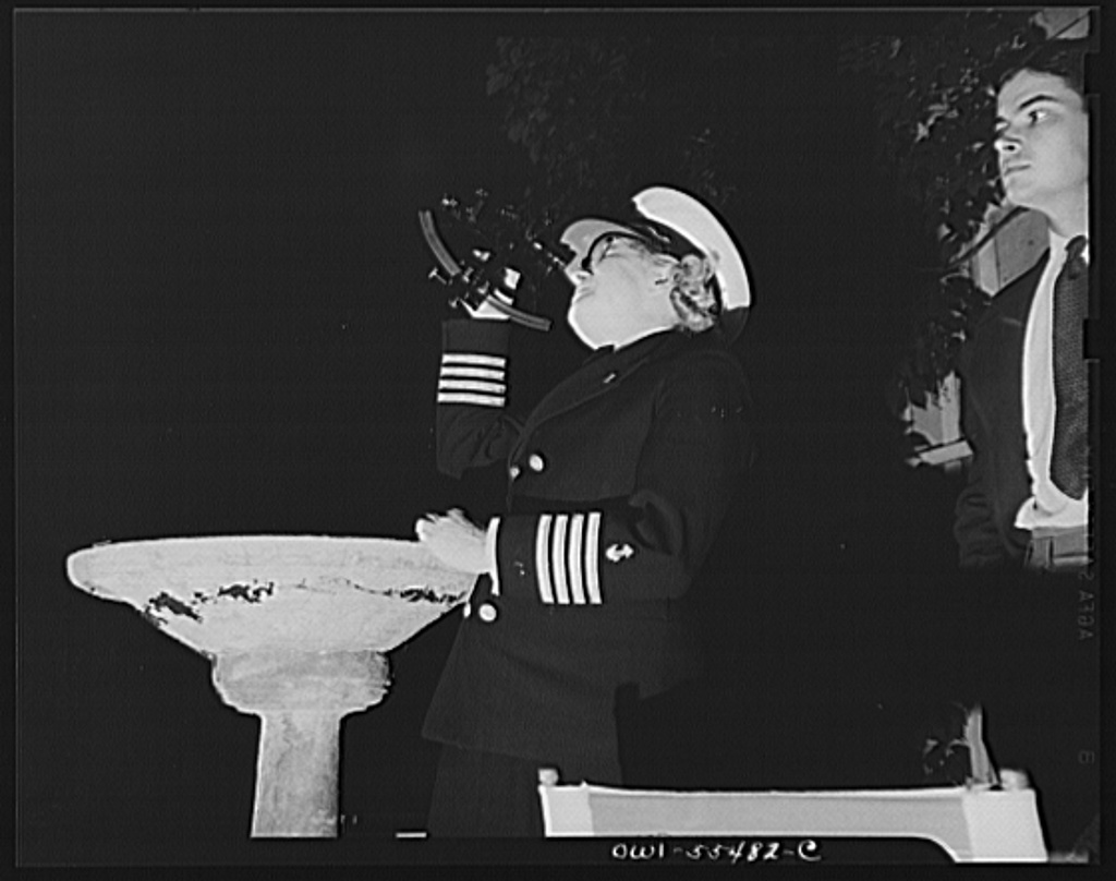 """""""Captain"""" Mary Converse, instructing V-7 (candidates for United States Navy ensign commissions) students in use of sextant, compass and gyroscope and in navigation. Captain Mary demonstrating the use of the sextant in locating one's position by the stars"""