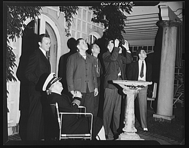"""""""Captain"""" Mary Converse, instructing V-7 (candidates for United States Navy ensign commissions) students in use of sextant, compass and gyroscope and in navigation. Using the sextant in the garden at night"""