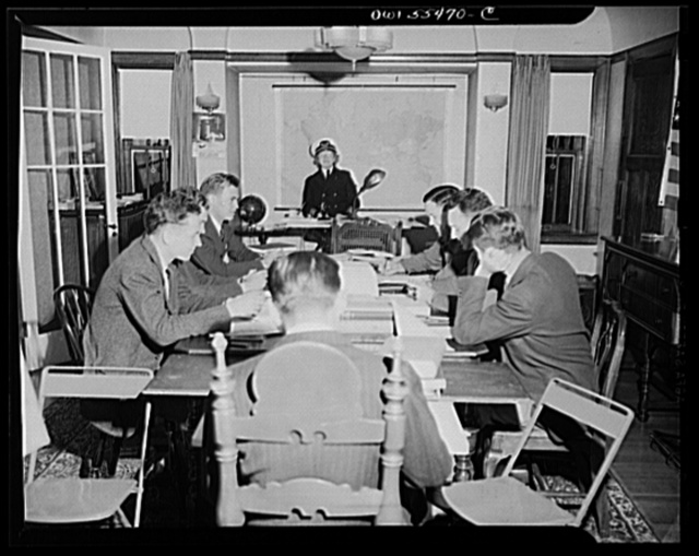 """Captain"" Mary Converse, instructing V-7 (candidates for United States Navy ensign commissions) students in use of sextant, compass and gyroscope and in navigation. Classes are held in dining room"