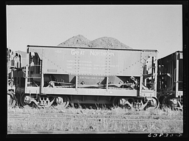 Car of iron ore from the Minnesota range in Great Northern Railroad yards. Superior, Wisconsin