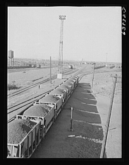 Cars of iron ore passing through the scales at Great Northern Railroad yards. Superior, Wisconsin