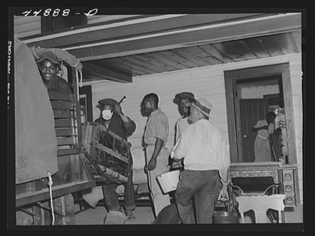 CCC (Civilian Conservation Corps) boys help move a family out of the area in Caroline County to be taken over by the Army for maneuver grounds. Virginia