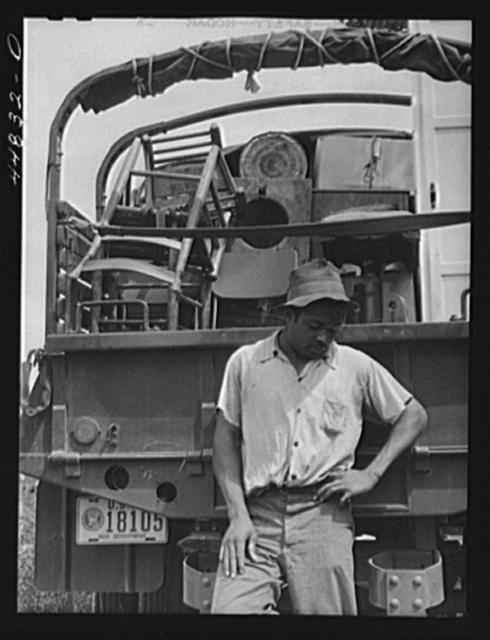 CCC (Civilian Conservation Corps) trucks are helping this young man's family move their belongings out of the area being taken over by the Army. Caroline County, Virginia