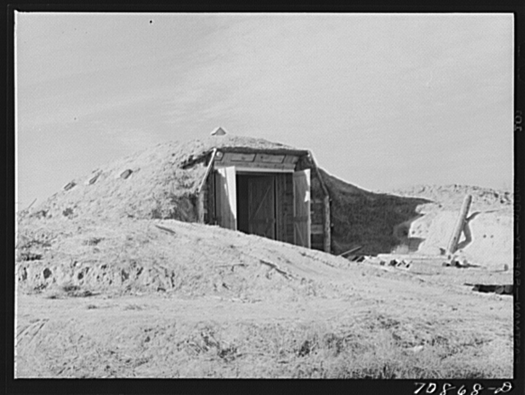 Cellar used for potatoes, canned goods, etc. on Black Canyon Project farm. Canyon County, Idaho