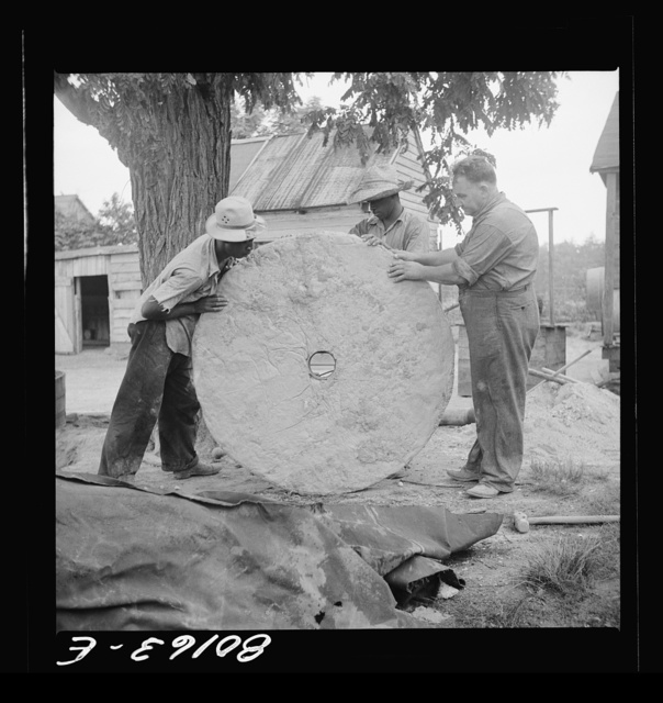 Cement cap after lifting from mould in ground. John Hardesty well project, Charles County, Maryland