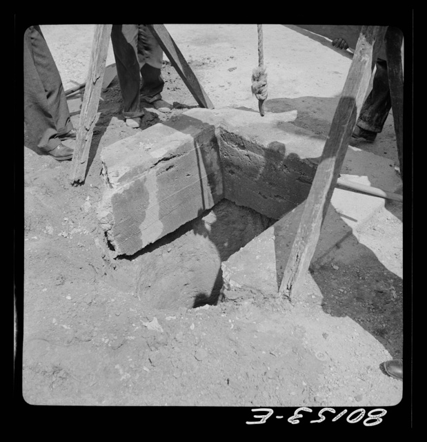 Cement lining partially broken away. John Hardesty well project, Charles County, Maryland