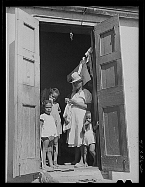 Charlotte Amalie, Saint Thomas Island, Virgin Islands. Family living in a slum section near the waterfront