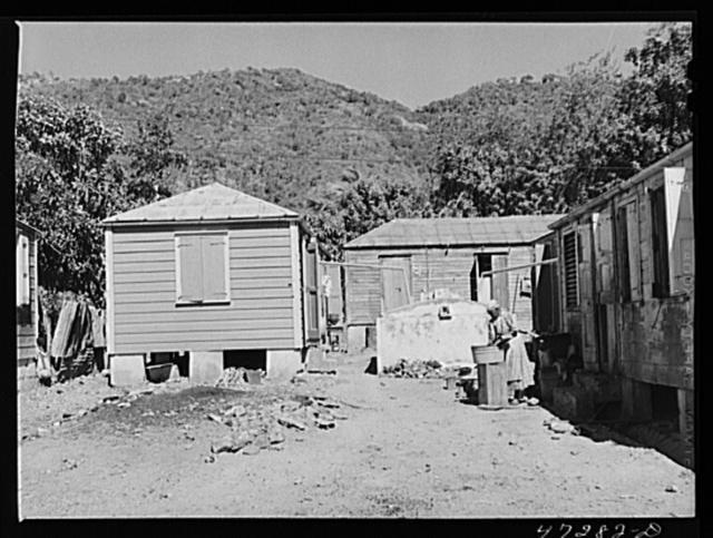 Charlotte Amalie, Saint Thomas Island, Virgin Islands. Washing clothes on a side street