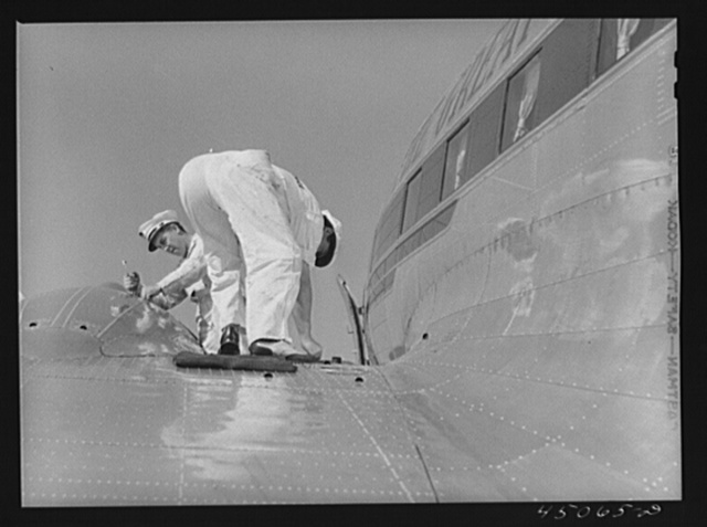 Checking the fuel of an airliner. Municipal airport, Washington, D.C.