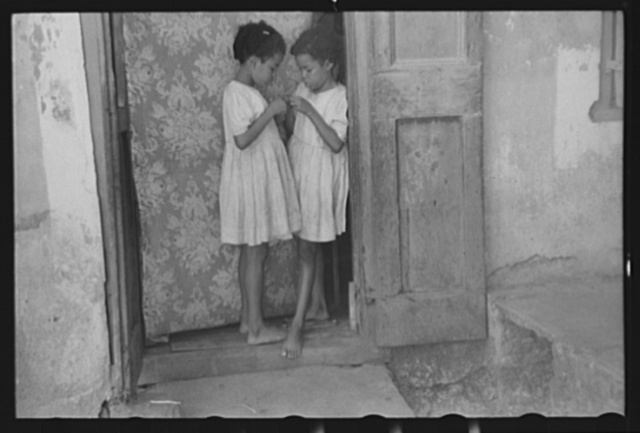 Children living in one of the substandard houses on a side street in Charlotte Amalie, St. Thomas, Virgin Islands