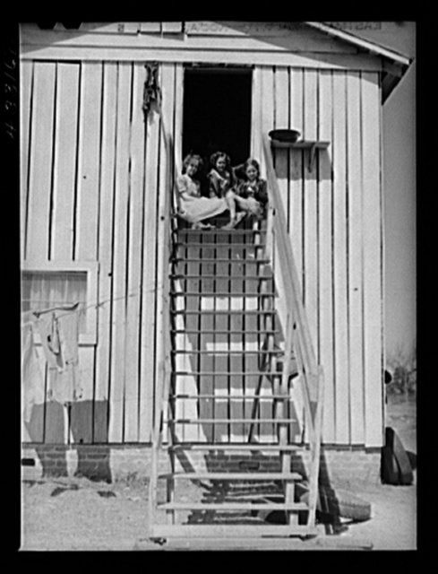 Children of workers from Fort Bragg living in a tobacco barn converted into living quarters near Fayetteville, North Carolina