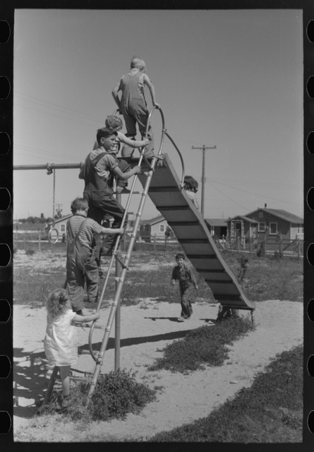 Children playing on slide at FSA (Farm Security Administration) labor camp, Caldwell, Idaho