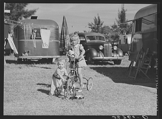 Children playing outside their trailer home at Sarasota trailer park. Sarasota, Florida