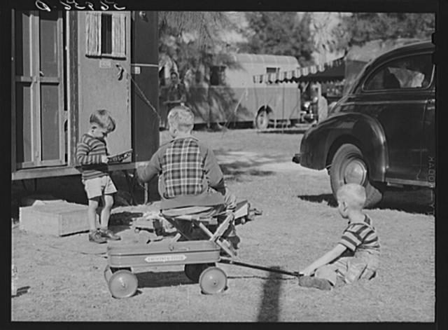 Children playing outside their trailer homes at Sarasota trailer park. Sarasota, Florida