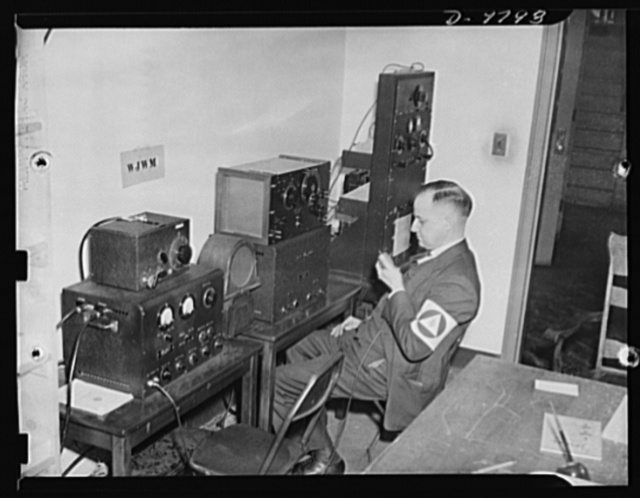 Civilian defense. War Emergency Radio Service. These three War Emergency Radio Service transmitter-receivers tuned to different wave lengths keep this Civilian Defense control center in touch with three different channels of communication. The set being operated maintains contact with state and city police and fire departments. The other two are used for communicating with sub-control centers, hospitals, and mobile field units