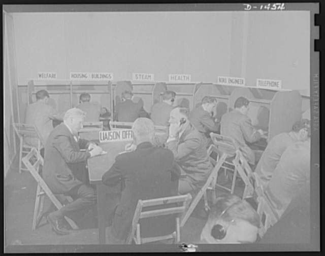 Civilian protection. Here is the way the report center is set up in New York City. The liaison officer keeps in touch with emergency forces which are indicated by the sings