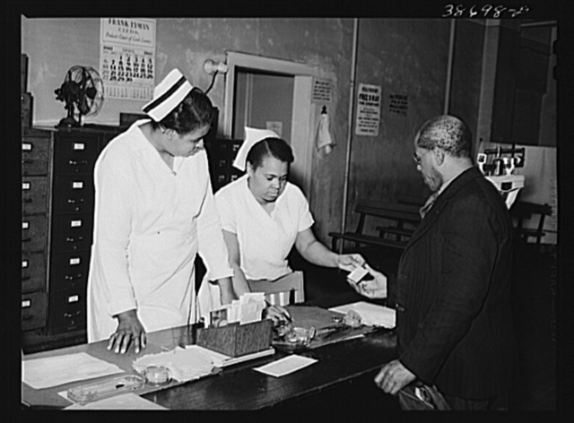 Clinic patient receiving instruction card at municipal tuberculosis sanitarium. Chicago, Illinois