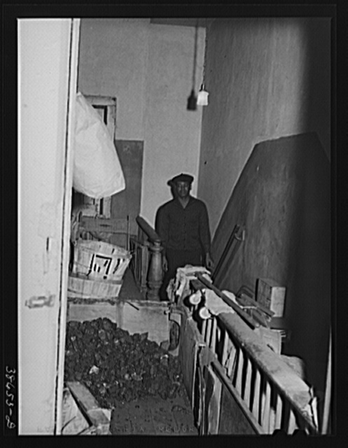 Coal storage in hall of apartment house rented to Negroes. Chicago, Illinois