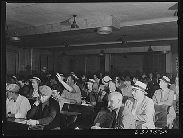 Commission merchants and their agents at early morning auction at fruit terminal. Chicago, Illinois. Auctions are held every morning but Sunday