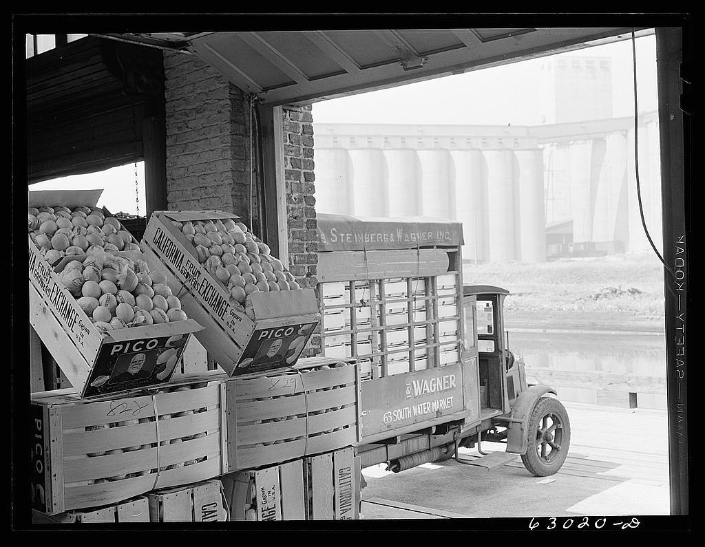 Commission merchants truck loaded at fruit terminal warehouse. Chicago, Illinois