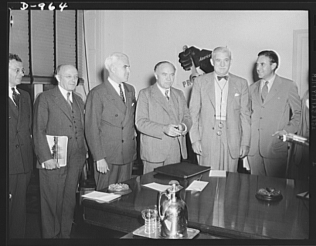 Conference held in the office of the Office of Production Management in Washington, D.C. August 19, 1941. Left to right: John Lord O'Brian, General Counsel, Office of Production Management; Edward R. Stettinius, Director of Priorities, OPM; Lord Beaverbrook, British Minister of Supply; William S. Knudsen, Director-General, OPM; W. Averill Harriman, Lend-Lease administrator in London