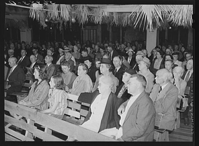 Congregation attending Sunday church services. Sarasota trailer park, Sarasota, Florida