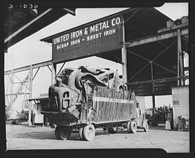 Conservation. Scrap iron and steel. A building truckload of discarded automobiles stripped of all usable parts and non-ferrous materials is delivered to a scrap iron dealer's processing plant in Baltimore, Maryland. This steel will be baled in huge hydraulic presses and sent to steel mills to feed the ever hungry furnaces now turning out steel for the national defense production program