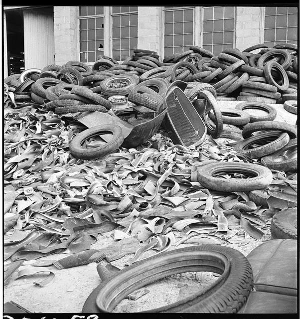 Conservation. Scrap iron and steel. Tire reclaimed from automobiles, scrapped for their iron and steel content. The rubber content of these tires can be reclaimed successfully to replace the use of new rubber in many articles. The U.S. Army is experimenting at the moment with the use of retreaded tires on trucks (U.S. Route 1,