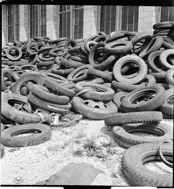 Conservation. Scrap iron and steel. Tires reclaimed from automobiles, scrapped for their iron and steel content. The rubber content of these tires can be reclaimed successfully to replace the use of new rubber in many articles. The U.S. Army is experimenting at the moment with the use of retreaded tires on trucks (U.S. Route 1,