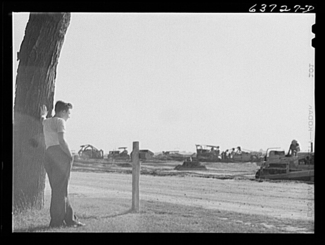 Construction on Ford bomber plant from front yard of adjoining farm. Near Ypsilanti, Michigan