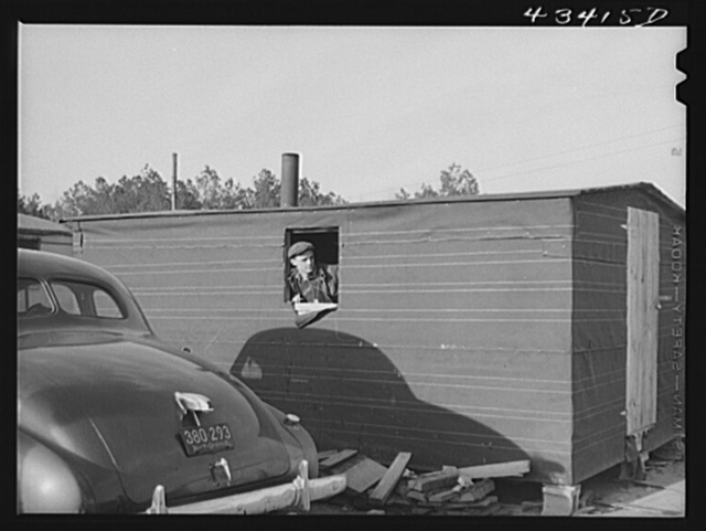 Construction worker from Fort Bragg who lives in this bunkhouse in a settlement near Manchester, North Carolina