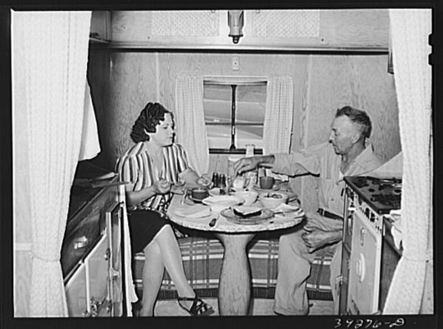 Construction worker of Kearney-Mesa and his wife have lunch in their trailer home. San Diego, California