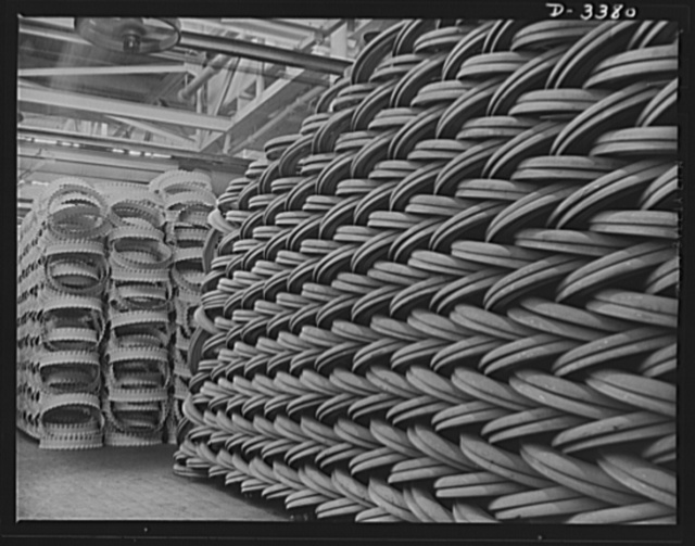 Conversion. Army truck parts. Rings and rims, piled to the ceiling in a large Midwest rubber factory now converted to production of war essentials. The spacer rings (left) and the side rings (right) are used for Army transports and supply trucks