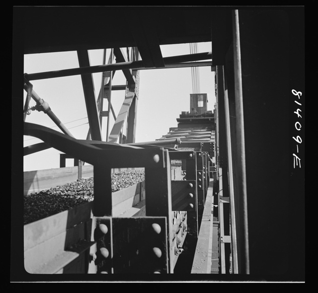 Conveyor belt carrying coal into the hole of Canadian collier at Oswego, New York