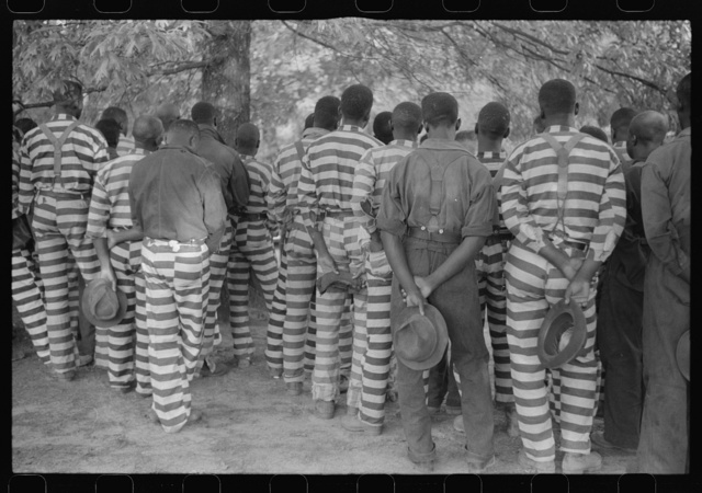 Convicts from the Greene County prison camp at the funeral of their warden who was killed in an automobile accident, Georgia